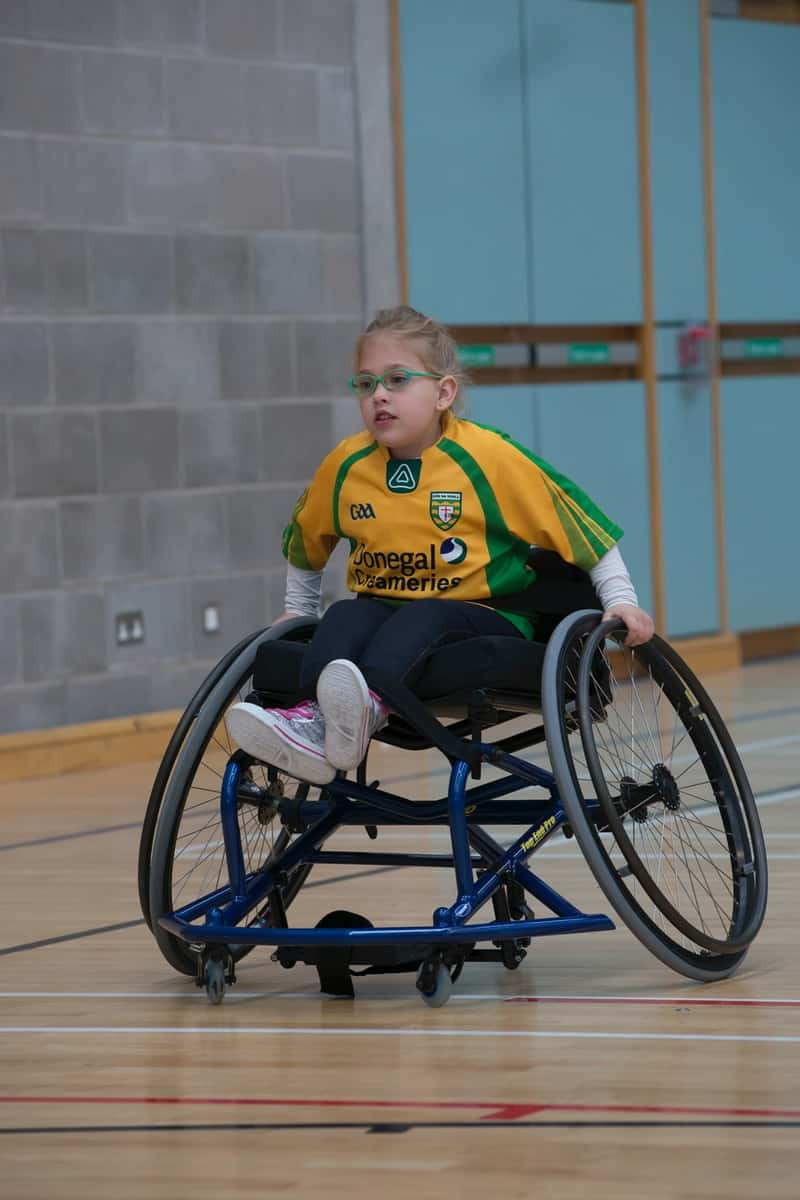 boy in yellow and black adidas hoodie sitting on black and gray wheel chair